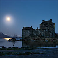 Eilean Donan Castle in moonlight - click for pictures of the castle and illuminations by Gerry Hofstetter